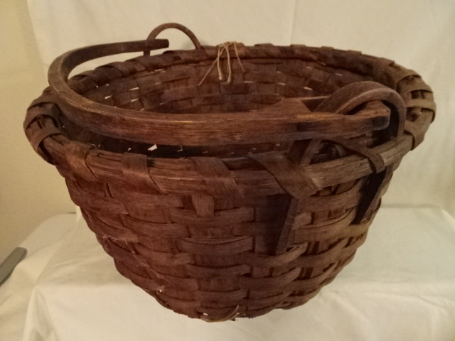 """#153 - Wood Rimmed Antique Handmade Basket - wooden bottom - unique handle rings - 15"""" round x 10"""" h - some damage"""